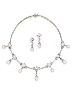 GOLD, PLATINUM, NATURAL PEARL AND DIAMOND NECKLACE AND EARRINGS. The garland-style necklace suspending 11 natural pearls measuring approximately 10.7 to 8.9 mm, accented by six old European-cut diamonds weighing approximately 7.15 carats, the earrings suspending two natural pearls measuring approximately 10.0 by 7.8 mm to 9.6 by 8.5 mm, both pieces set throughout with numerous old European, old mine and rose-cut diamonds; circa 1900.