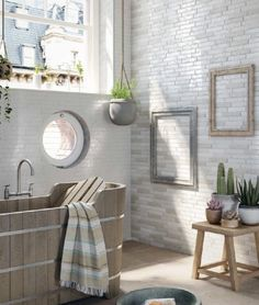 Use complimentary tile on different walls to create a personalised bathroom #homedecor