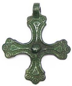 This is a rare and beautiful Viking bronze cross pendant, dating to the 10th - 11th century AD. The cross is a nice example, with a plethora of decoration in the form of ring and dot annulets. Such pendants were worn by the newly Christianized Vikings, taking the place of the Thor's hammer. This is a very nice example, mostly we find then badly corroded or with damaged suspension loops. This example still has a thick suspension loop, with plenty of life in it. As such this pendant would…