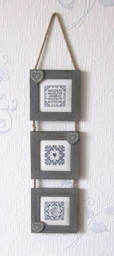 Trio of embroideries - 3 cross stitch patterns using DMC cotton No. 930 on white Zweigart 8 count Aida fabric