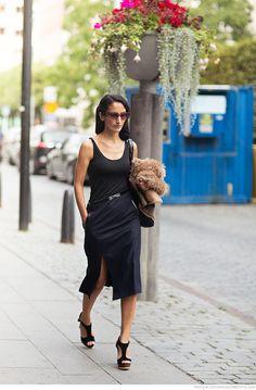 Black vest, knee length split skirt, heels