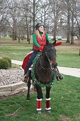 SMWC's equestrian teams serenade the campus with Christmas carols.