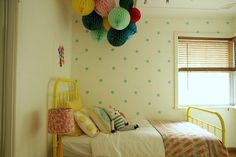 Stenciled walls are increasingly popular features in nurseries and kids' rooms: they are cheap, easy to create, relatively easy to remove (just re-paint), and add a touch of fun. But...what if you can't paint? Well, Emily, who decorated this room for her daughter Pippi, had the perfect solution: decals!