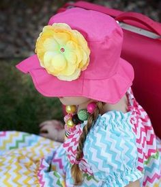 Brighten up your kids spring wardrobe with this adorable Raspberry Sun Hat w/ Yellow Rose