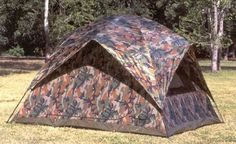 "Texsport 5 Person Headquarters Camo Square Dome Family Camping Backpacking Tent. Spacious five-person tent measures nine-by-six-by-nine feet (W x H x D). Easy set-up and take-down thanks to two-pole, pin-and-ring frame system with shock-corded fiberglass poles and speed clips. D-style front door made of ""no-see-um"" mesh, mesh rear and side windows with zippered storm flaps, four mesh roof panels, zippered storm flap, and half-length four-peak rainfly. Taffeta material has water-resistant..."