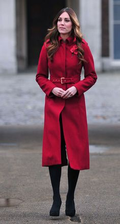 Joining hubby Prince William in London, Kate looked lovely in a poppy coat worn especially for—wait for it—Poppy Day (the U.K.'s Remembrance Day memorial holiday). Kate actually wore the appropriately-hued L.K. Bennett number back in 2011, but styled with a flashier wide crocodile belt. (Go Kate with your easy, inventive styling tricks!) For today's outing, she opted for the waist cincher that matches the jacket.  And fun fact: She took public transportation to the event!