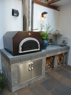 Awesome outdoor kitchen with a Belgard pizza oven from the House Beautiful 2012 Kitchen of the Year.
