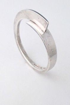 "Soren Borup, Denmark material: sterling silver size: fins 1/2"", inside 2 3/16"" x 1 7/8 (fits a slender wrist) This bracelet is…"