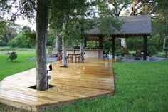 Love the decking around the trees...