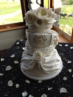 White floral Topsy Turvy Wedding Cake  Cake by LMCakeDesign