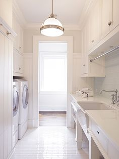A pendant light and under cabinet lights will make this laundry room nice and bright to work in.
