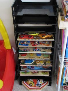 Boogie has a TON of puzzles. They were all heaped in one of the larger boxes in our storage bin rack in the play room. The pieces were jumbl...