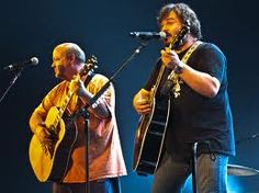 Tenacious D.... kyle wears this ratty orange shirt at every gig. He is my idol