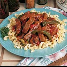 Crockpot pepper steak  1-1/2 pounds beef top round steak; 2 tablespoons canola oil; 1 cup chopped onion; 1/4 cup reduced-sodium soy sauce; 1 garlic clove, minced; 1 teaspoon sugar; 1/2 teaspoon salt; 1/4 teaspoon ground ginger; 1/4 teaspoon pepper; 4 medium tomatoes, cut into wedges or 1 can (14-1/2 ounces) diced tomatoes, undrained; 1 large green pepper, cut into strips; 1 tablespoon cornstarch; 1/2 cup cold water; Hot cooked noodles or rice.
