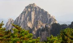 Jade Screen Tower with hotel and Heavenly City Peak from Brightness Top on Huangshan China