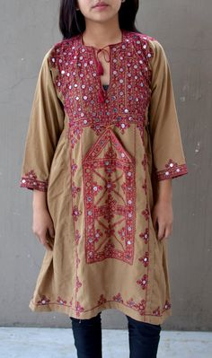 Traditional Afghanistan balochi in olive brown with red embroidery and mirror work.  Tiny mirror discs are embroidered in place over the dress.