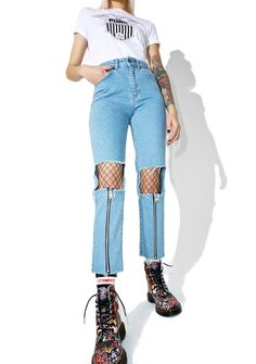 The Ragged Priest Scratch Jeans don't leave yr claw marks on me, babe. These dope mom jeans feature a light wash denim construction, high waisted cut, slim-straight cut, cutout knees, zip front detailing from the knee to the hem, and zipper fly 'N button closure.