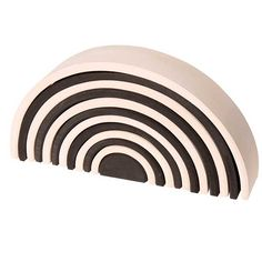 Monochrome Rainbow Stacking Tunnel (Grimm's) A new twist on an old favorite! The boldly contrasting black and white pieces offer a modernist take on the Grimm's Spiel und Holz stacking rainbow. A toy that truly is not just for kids!