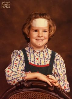 """""""This is my first grade school picture. I was still healing from a very nasty bike wreck where I completely ate it on a huge hill and took a big chunk out of my forehead and broke my middle finger, among other general road rash nasties. I guess it didn't bother me too badly- either that or I had the fake smile down-pat. I have to give props to my mom who ordered a complete package of photos from this year just like every other… giant band-aid and all."""""""