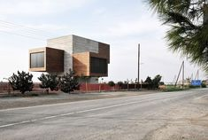 Located on the coast in a very pristine earea near Larnaca, Cyprus, this house comprises four 'boxes' placed around a central element, a 'tower'.