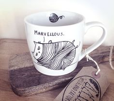 A hand painted, unique MUG with a slightly clumsy Mr. Cat, who loves playing with wool balls. Perfect for a cuppa tea, morning coffee or a solid portion of milk:) A perfect gift for all cat addicts:) Original design, hand painted - not transferred. Double sided illustration: Front: Mr. Cat + wool ball Back: The consequence of the wool ball misuse:) - Mr. Cat tangled up in wool, muttering Marvellous. * Theres a tiny wool ball symbol inside the mug:) It has been hand signed on the reverse. ...