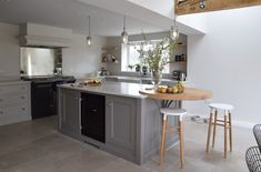 Guild Anderson kitchen in Farrow and Ball Purbeck Stone and Moles breath island.