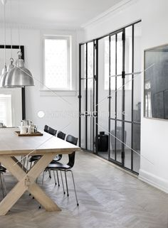 Black lead light doors and wooden table