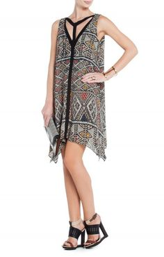 $175.00 Head to all tomorrow's parties in this stunningly unique patchwork-pattern piece with femme-fatale charm. Round neck. Sleeveless.Allover pattern. Cutout embellished bodice. T-strap at back.Contrast color-blocked overlay at neckline and center front.Contrast solid back. Asymmetrical handkerchief hem.Georgette: Polyester. Crepe de Chine: Polyester.Hand Wash.Imported.