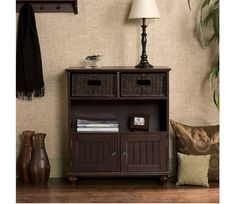 Storage/Display Console - This beautiful rich espresso finish storage console is a must-have addition to your home! This unique console delivers traditional storage and a display shelf. Above the display shelf are two rattan drawers for placemats, silverware and accessories. Beneath are 2 divided storage areas enclosed with artfully crafted doors accented with brushed nickel doorknobs. www.millstores.com