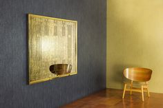 Large mirror in brass with stepped frame and geometric fretwork finished with antiqued glass...shown above unique embossed leather floor