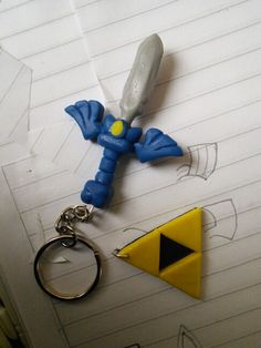 Polymer clay Zelda Master Sword and Triforce
