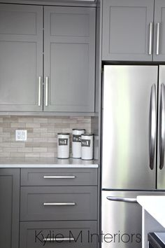 Kitchen cabinets painted Benjamin Moore Amherst Gray, driftwood marble backsplash with stainless steel. Design by Kylie M Interiors E-Design, Vancouver Island Decorating Services