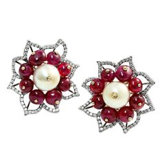 For Sale on - A stunning pair of Mughal-style natural, saltwater pearl earrings, weighing approximately grains each, clustered with natural, no heat ruby beads