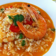 Portuguese rice dish with assorted seafood in a tomato and beer gravy. Seafood Rice Recipe, Rice Recipes, Seafood Recipes, Cooking Recipes, Tomato Rice, Portuguese Recipes, Portuguese Rice, Fresh Seafood, Healthy Dishes