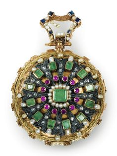 A TWO-COLOR GOLD OPEN FACED POCKET WATCH, FRENCH, CIRCA 1770, SIGNED BOSCHERON ROUEN, SET WITH EMERALDS, RUBIES, SAPPHIRES AND PEARLS, the movement with golden platinum with openwork cock, the white enamelled dial indicating the hours in Arabic numerals, surrounded by a frieze alternating pearls and emeralds, the hands and the gold case, the reverse A rosette of emeralds, fine pearls, rubies and diamonds surrounded by a frieze of interlacing, the golden bail set with fine pearls and…