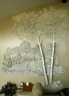 Tom Moberg Gypsum plaster wall sculpture incorporates a swinging bridge in the background.