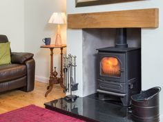 Snuggle up by the log burning stove at Lund Cottage in Lamplugh!