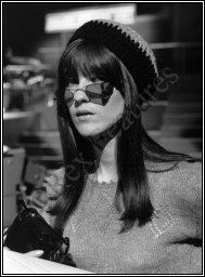 Cathy in shades and a knit cap