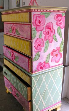 Sweet little girl's painted dresser. Notice even the sides of the drawers are painted gold.