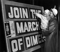 A toddler inserts a dime into a March of Dimes collection board as her mother holds her and looks on. The collection is to raise money to eradicate polio. RECORD DETAILS Image ID:8532 Creation Date:1955-01-05 Creator Name:Milwaukee Journal Sentinel City:Milwaukee County:Milwaukee State:Wisconsin Collection Name:Classified File Genre:Photographs March Of Dimes, Milwaukee County, A Dime, Historical Society, Detailed Image, How To Raise Money, Vintage Photography, Wisconsin, Hold On