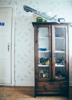 wooden cabinet with glass for toys