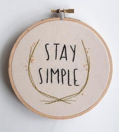"""A lovely reminder for those days when everything seems to be going wrong and you're getting kinda sick of reading status updates. This hand-embroidered wall art is lovingly-stitched with """"Stay Simple."""" And it's a good idea too, you know."""