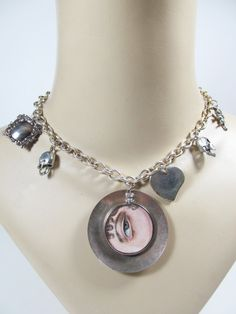 Mixed vintage charm necklace with handpainted eye by SAULSOGALLERY