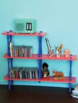 Transform an old shelving unit with funky hot pink and bold blue colours. Resene Desire and Resene Elivs look great together. The background wall is finished in Resene Onepoto.