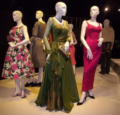 Costumes from The Help. I love Hilly's garden dress on the left, despite the fact that I greatly dislike her. ;-)