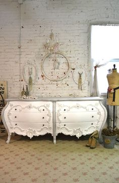 A beautiful simply chic French dresser for your cottage boudoir! FEATURES: Sturdy solid wood construction with romantic French Louis XV provincial style. Twelve dovetail drawers with glass knobs rose appliques and Queen Anne legs. FINISH: Painted with our cottage white and distressed just right. MEASURES: DELIVERY OPTIONS: WE SHIP TO ALL STATES WITHIN THE CONTINENTAL US AND CANADA INTERNATIONAL SHIPPING AVAILABLE (contact us for details) PICK UP is welcomed at our studio locate...