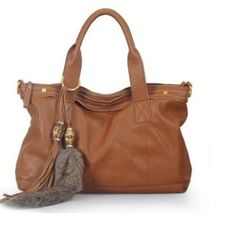 PM EDITOR'S PICK Cuore & Pelle Amalia Bag Currently out of stock on their website this fabulous bag has a detachable shoulder strap, tons of space and lots of pocket.  It is made of the softest high quality leather. Cuore & Pelle Bags