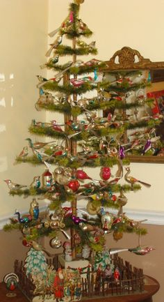 Antique feather tree with clip on birds from a private collection in Missouri http://www.hometraditions.com/antique_christmas_in_missouri_s/1952.htm