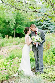 Fanny hill wedding with grey groomsmen suits and emerald for Wedding dresses eau claire wi