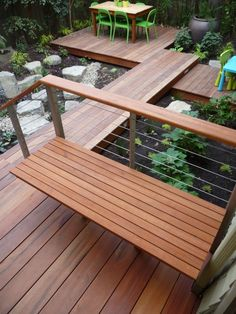 if we want built-in seating with a less-heavy railing... tigerwood deck with cable railing.